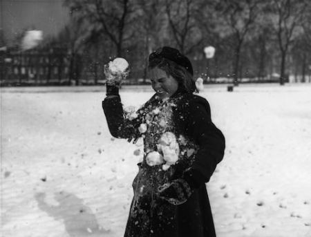 2nd march 1954 a young girl being hit by a snowball whilst playing in st james park, london